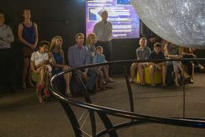 Families get a preview of the new Science on a Sphere display 07/15/19 at the Blakemore Planetarium. The 6 foot sphere, presented by Cimarex, utilizes four projectors to display multiple images of the earth as well as planets, moons and the sun. Tim Fischer/Reporter-Telegram