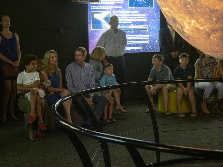 Families get a preview of the new Science on a Sphere display 07/15/19 at the Blakemore Planetarium. The 6 foot sphere, presented by Cimarex, utilizes four projectors to display multiple images of the earth as well as planets, moons and the sun. Tim Fischer/Reporter-Telegram Photo: Tim Fischer/Midland Reporter-Telegram