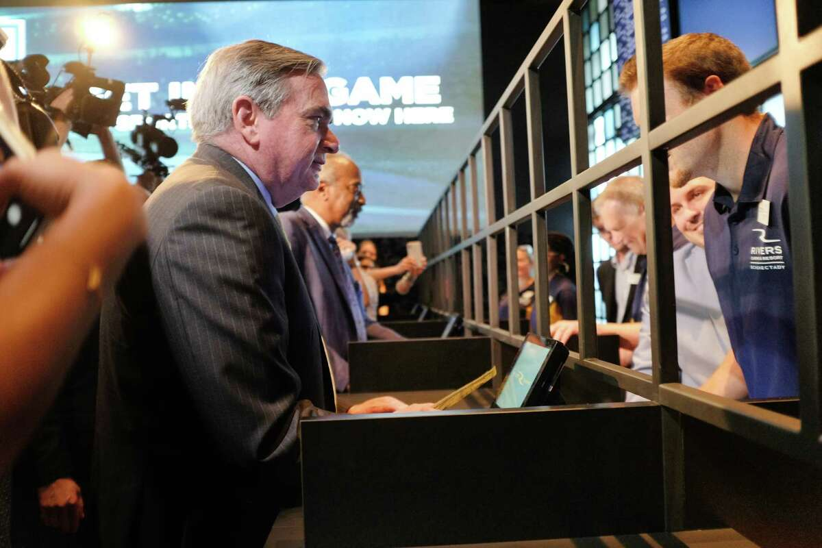 Schenectady Mayor Gary McCarthy makes one of the first sports bets at the Rivers Sportsbook on Tuesday, July 16, 2019, in Schenectady, N.Y. (Paul Buckowski/Times Union)
