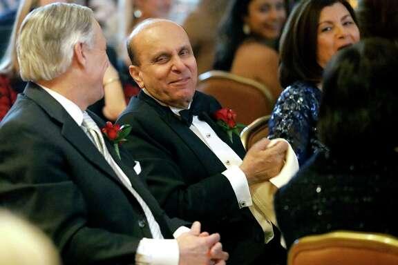 S. Javaid Anwar (right) laughs with Texas Governor Greg Abbott during the Permian Basin Petroleum Association's Top Hand award banquet honoring Anwar, Jan. 17, 2018, at the Petroleum Club. James Durbin/Reporter-Telegram