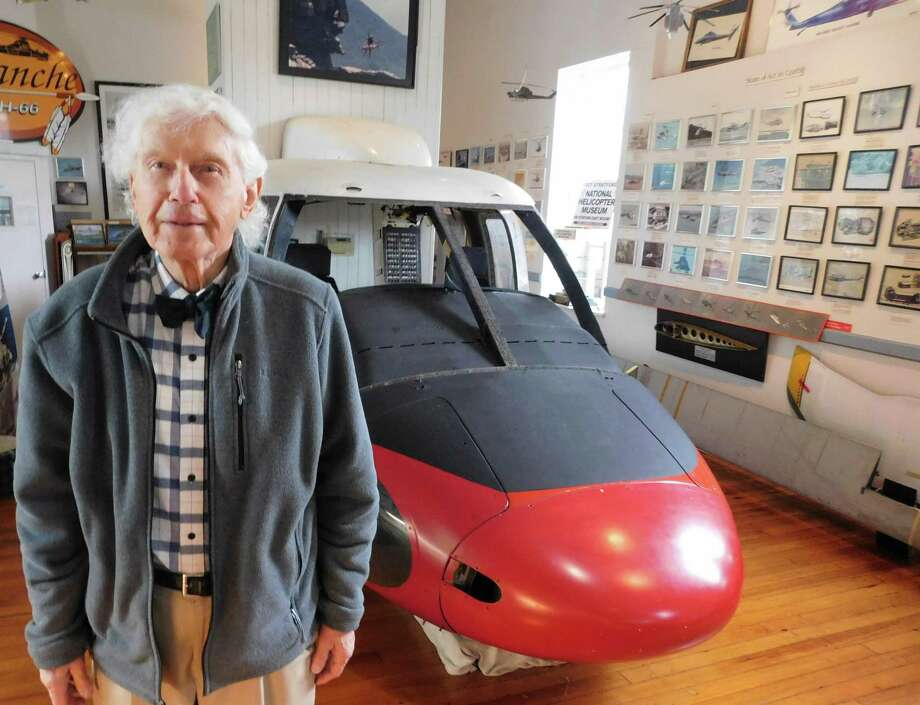 National Helicopter Museum founder Raymond Jankowich stands in front of the Sikorsky S-61 helicopter front section on display at the Stratford nonprofit institution. Photo: Brad Durrell / For Hearst Connecticut Media