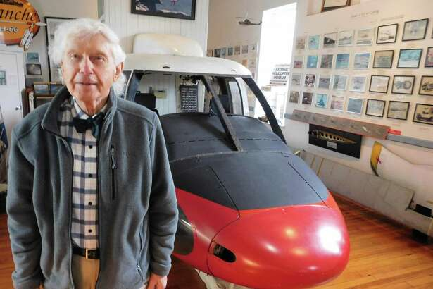 National Helicopter Museum founder Raymond Jankowich stands in front of the Sikorsky S-61 helicopter front section on display at the Stratford nonprofit institution.