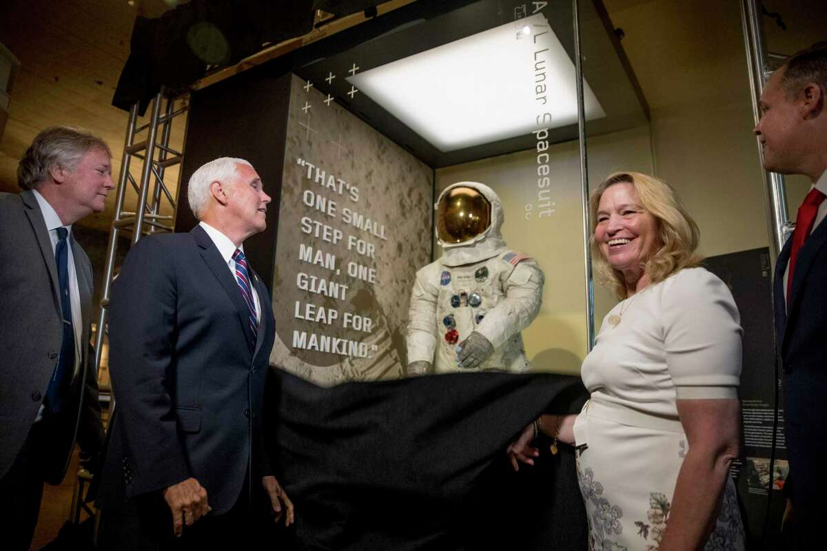 From left, Rick Armstrong, the son of Neil Armstrong, Vice President Mike Pence, Smithsonian's National Air and Space Museum Director Ellen Stofan, and NASA Administrator Jim Bridenstine unveil Neil Armstrong's Apollo 11 spacesuit at the Smithsonian's National Air and Space Museum on the National Mall in Washington, Tuesday, July 16, 2019. (AP Photo/Andrew Harnik, Pool)