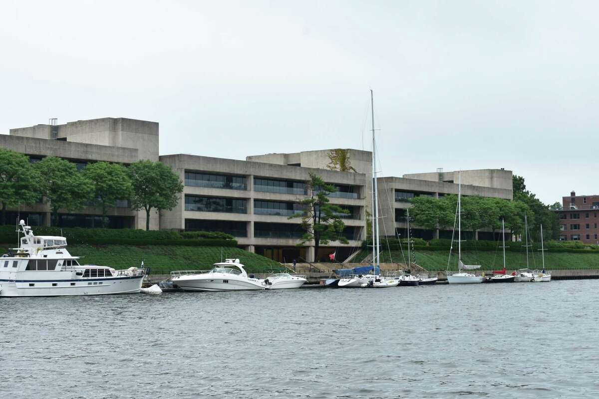 Yachts line Greenwich Harbor in July 2018 outside the multi-tenant office building at 600 Steamboat Road in Greenwich, Conn.