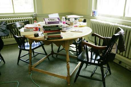 Textbooks fill a table in a building on the campus of Dartmouth College in Hanover, N.H. on June 2, 2009.