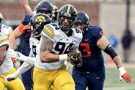 Iowa's AJ Epenesa, a sophomore defensive end from Edwardsville High, runs the ball into the end zone after forcing and then recovering a fumble in the first half on Nov. 17 at Illinois.