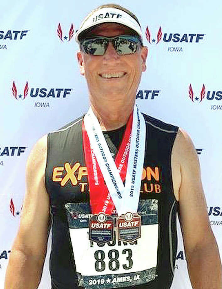 Mike Young of Wood River wears the second- and third-place medals he captured at last week's USATF Masters Track and Field Championships in Ames, Iowa. Photo: Submitted Photo