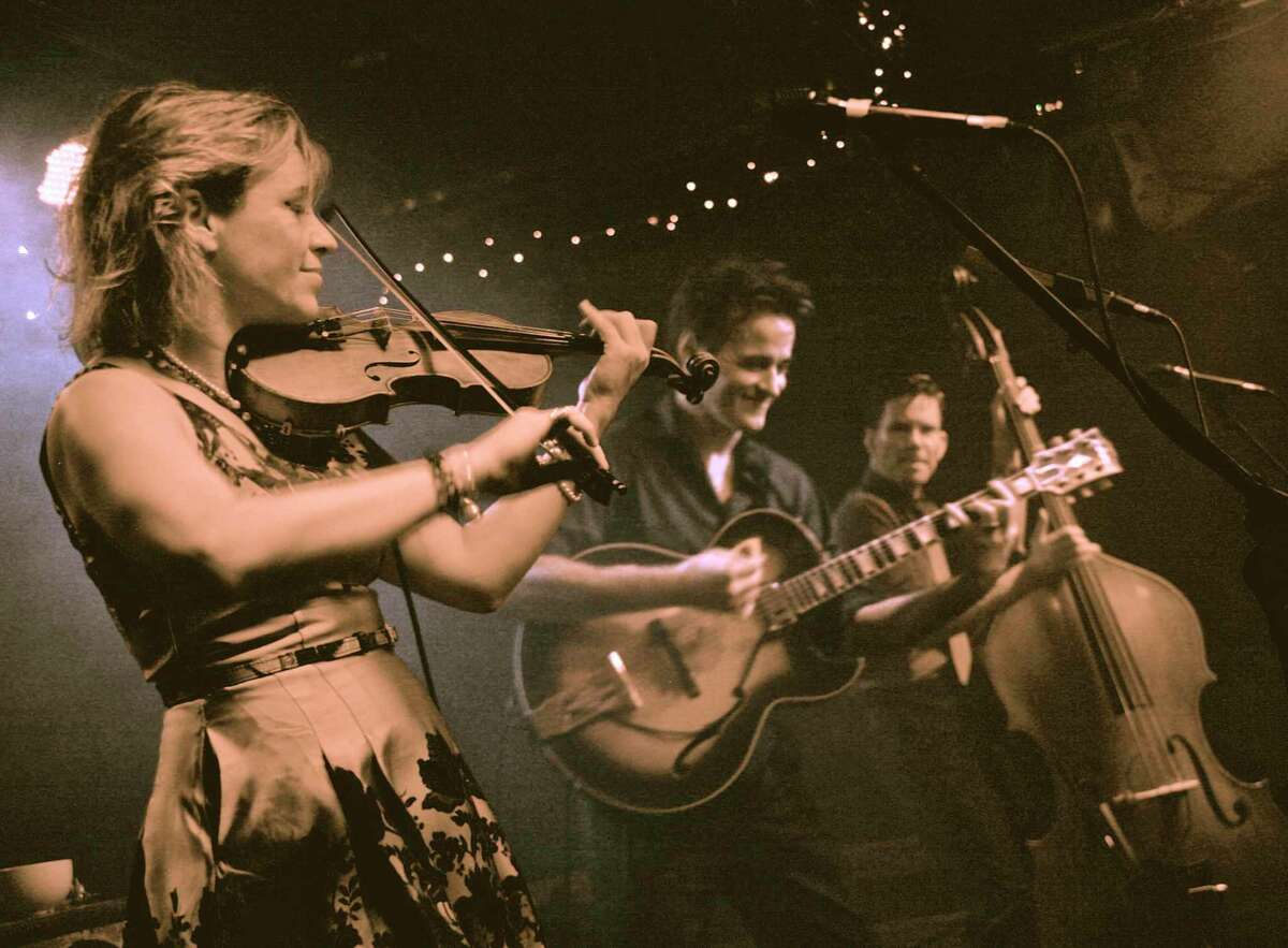HOT CLUB OF COWTOWN: The Hot Club of Cowtown is a hot jazz/western swing trio, comprising Elana James (formerly Fremerman) (vocals, violin), Whit Smith (vocals, guitar), and double bass player Jake Erwin. They also sing in three-part harmony.