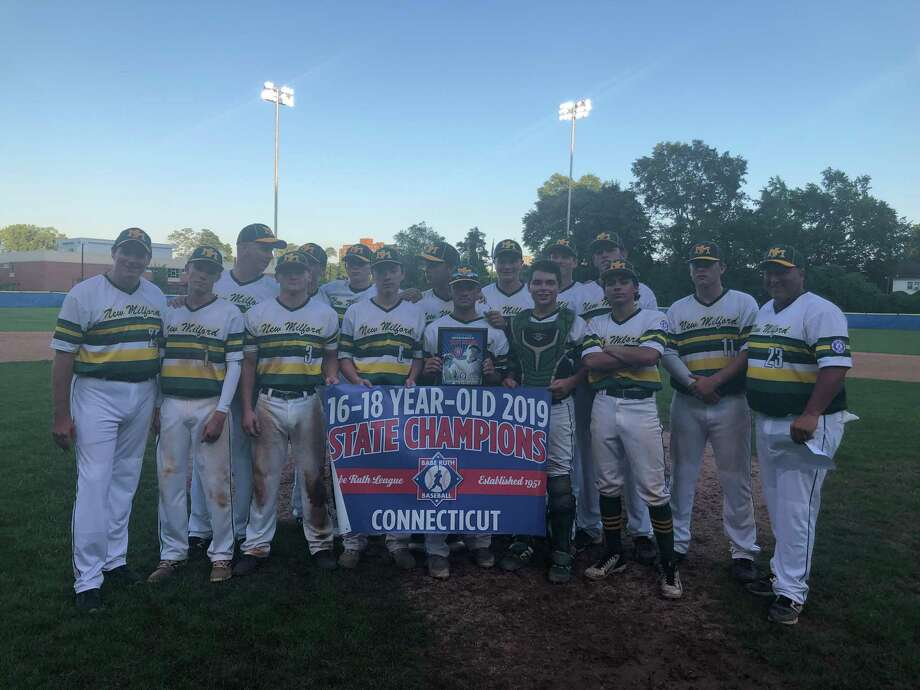 Members of the New Milford 16-18 Babe Ruth team celebrate their state championship victory over Stamford. Photo: Will Aldam / Hearst Connecticut Media