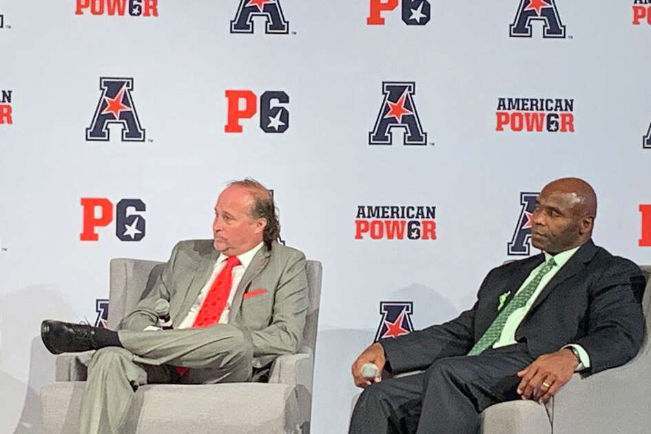 University of Houston football coach Dana Holgorsen and South Florida's Charlie Strong during Day 2 of the AAC Media Days.