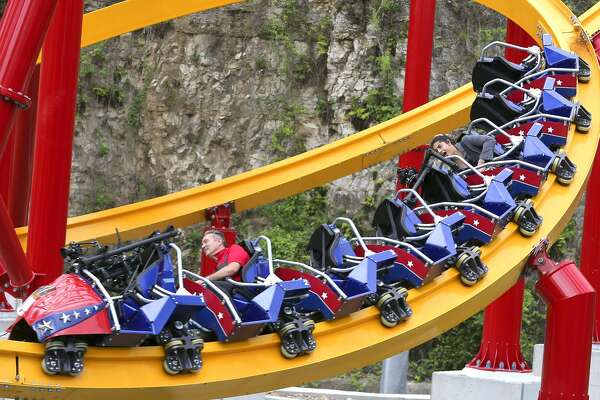 Six Flag Fiesta Texas' new roller coaster the Wonder Woman Golden Lasso will open Saturday. Seats on the ride straddle a 15 ½-inch rail and the coaster was designed by Alan Schilke of Rocky Mountain Construction.