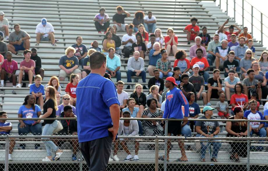 West Brook football coach Eric Peevey addresses a crowd who met at Durley Stadium during Sunday's prayer service for the four Bruin football players injured in a car wreck this weekend. Photo taken Sunday, 7/14/19 Photo: Guiseppe Barranco/The Enterprise, Photo Editor / Guiseppe Barranco ©