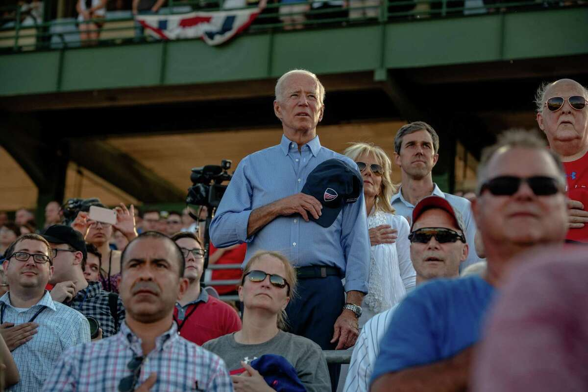 Former Vice President Joe Biden, Jill Biden and Beto O'Rourke attend an the Iowa Cubs baseball game in Des Moines, Iowa, July 4, 2019. After weeks of facing sharp criticisms over his decades-long history on issues including busing and civil rights, Biden is expected on Saturday to give the most forceful defense yet of his record, with an emphasis on his time as vice president to Barack Obama, the country's first black president. (Hilary Swift/The New York Times)