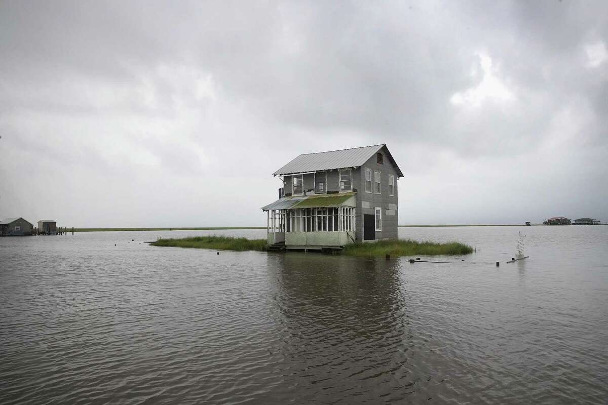 Water recedes from around a fish camp following Hurricane Barry on July 14, 2019 in Wilkerson Bayou, Louisiana. The storm, which made landfall as a category one hurricane near Morgan City, caused far less damage than had been predicted but bands of rain and thunderstorms continue to soak the area.
