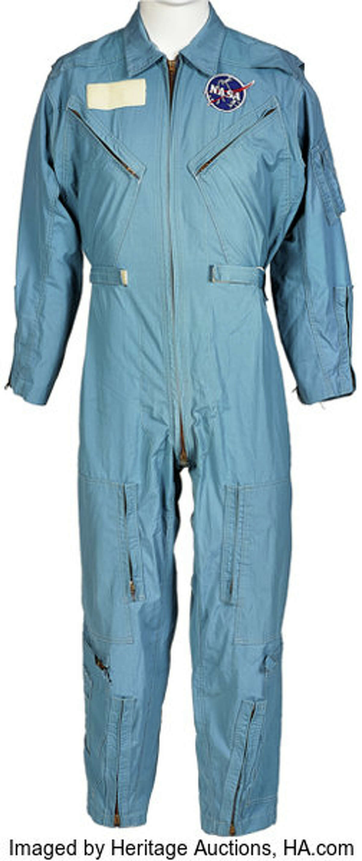Neil Armstrong's personally owned and worn early-Apollo era flight suit with type 3 NASA vector patch is among dozens of items up for auction until Thursday. Starting/early bids: $40,000 >>> See more items up for auction