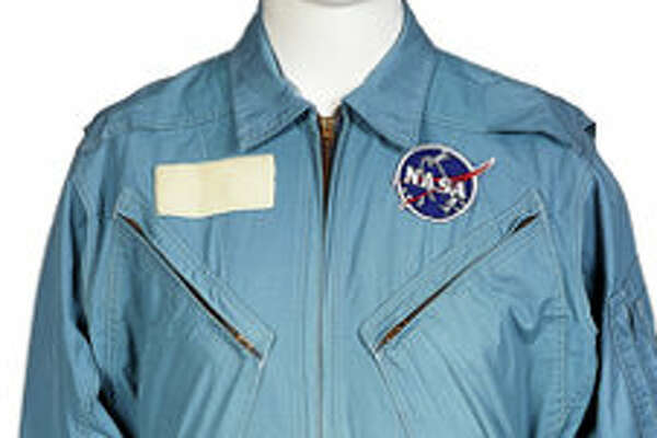 Neil Armstrong's personally owned and worn early-Apollo era flight suit with type 3 NASA vector patch Starting/early bids: $40,000
