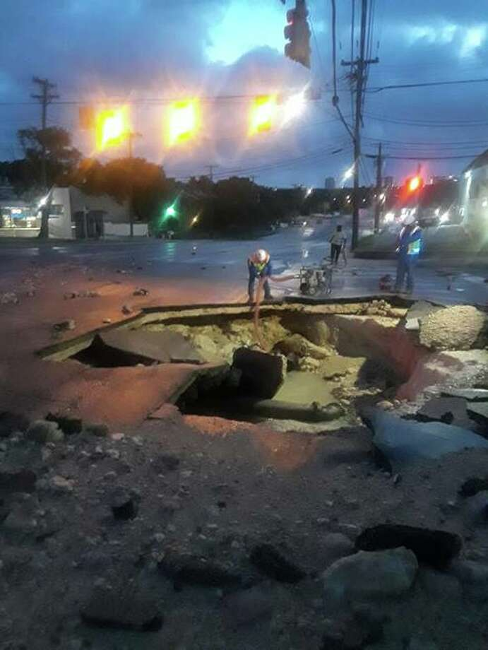Local emergency crews are currently working to fix a water main break that broke on the city's Northwest Side early Tuesday morning, according to officials at the site. Photo: Leon Valley Fire Department