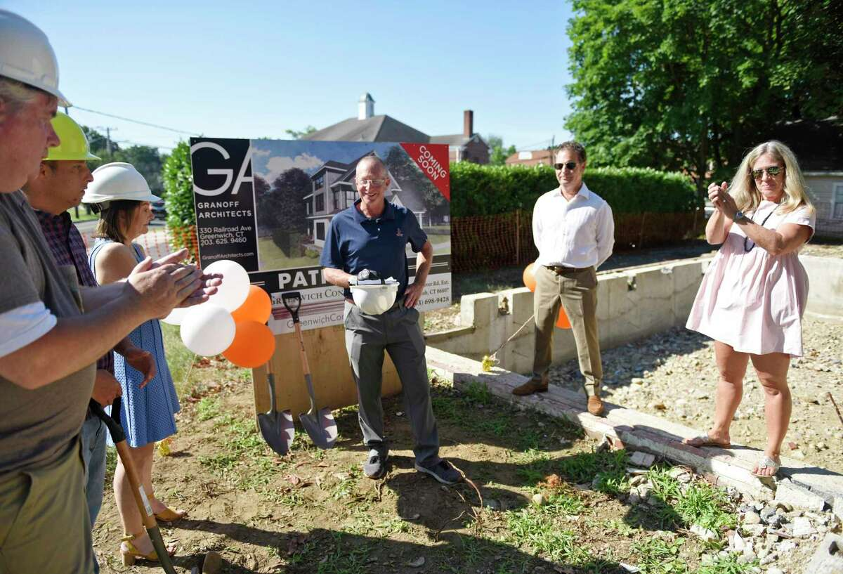 Pathways Board of Directors President Jim Weil, center, speaks at the groundbreaking of the new Pathways Fellowship Center in the Cos Cob section of Greenwich, Conn. Tuesday, July 16, 2019. Pathways, a local organization that supports people living with chronic mental illness, demolished its former building at the same site and will begin rebuilding a new and improved building to assist its clients.