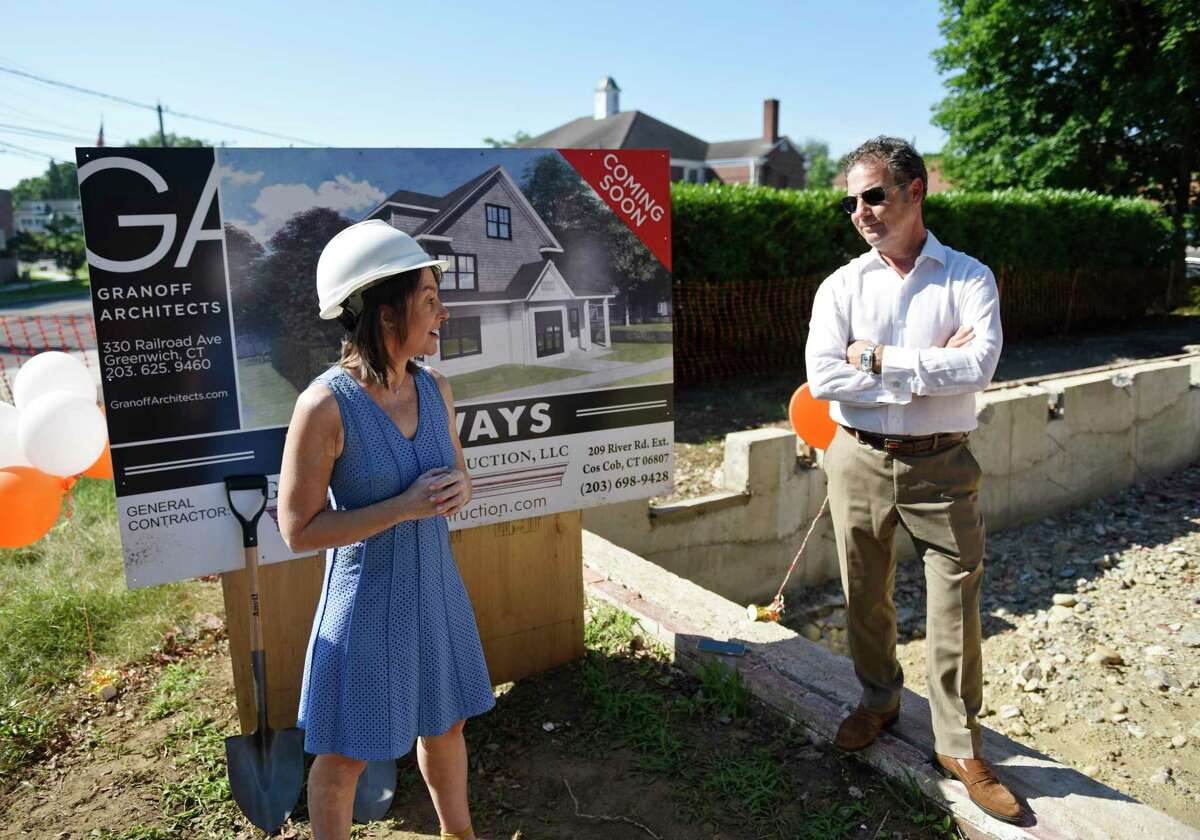 Pathways Executive Director Laura Heckman speaks beside architect Richard Granoff at the groundbreaking of the new Pathways Fellowship Center in the Cos Cob section of Greenwich, Conn. Tuesday, July 16, 2019. Pathways, a local organization that supports people living with chronic mental illness, demolished its former building at the same site and will begin rebuilding a new and improved building to assist its clients.