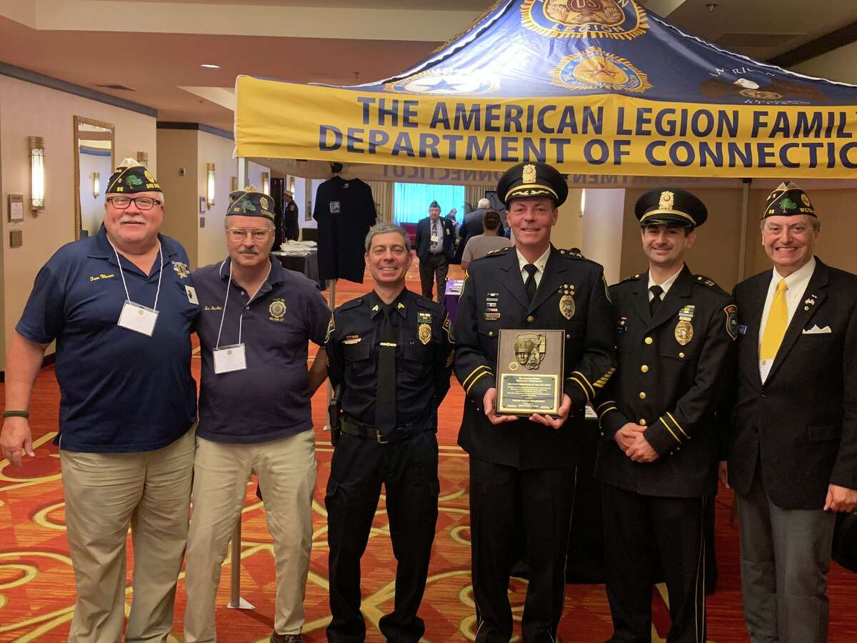 From left, Post 86 Adjutant Tom Moore, Post 86 Judge Advocate Bud Boucher, Wilton Police Sgt. Arnault Baker, Capt. Rob Cipolla, Chief John Lynch, and Post 86 Commander Bill Glass at the awarding of Police Department of the Year Award at the 101st annual American Legion Department of Connecticut Convention, in Trumbull, July 12-14.