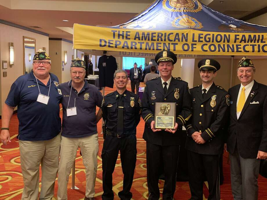 From left, Post 86 Adjutant Tom Moore, Post 86 Judge Advocate Bud Boucher, Wilton Police Sgt. Arnault Baker, Capt. Rob Cipolla, Chief John Lynch, and Post 86 Commander Bill Glass at the awarding of Police Department of the Year Award at the 101st annual American Legion Department of Connecticut Convention, in Trumbull, July 12-14. Photo: Contributed Photo / American Legion Post 86 / Wilton Bulletin Contributed