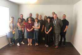 Employees from Woodforest National Bank recently completed its second home for Habitat for Humanity of Montgomery County for a mother and daughter.