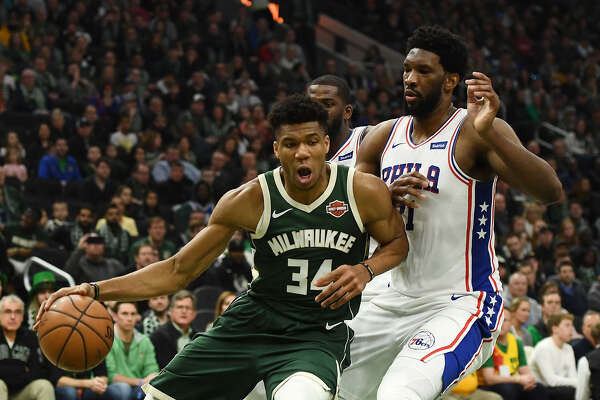Giannis Antetokounmpo's (left) and Joel Embiid's teams are among the returning Eastern Conference favorites, but it won't be a two-team race.