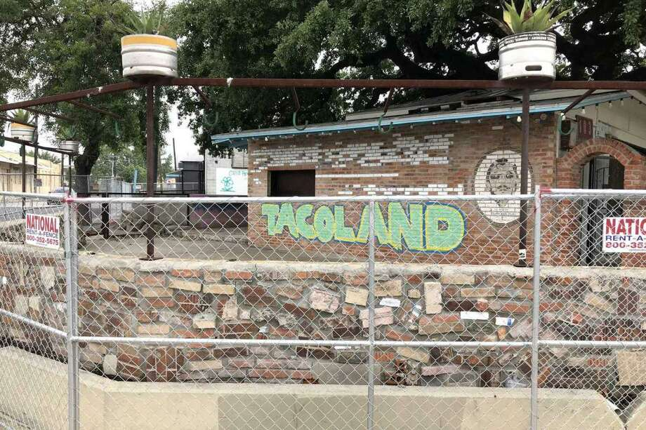 Chain-link fencing encircles the former home of Viva Tacoland at 103 W. Grayson St. The business closed in late April. Photo: Paul Stephen / Staff File Photo