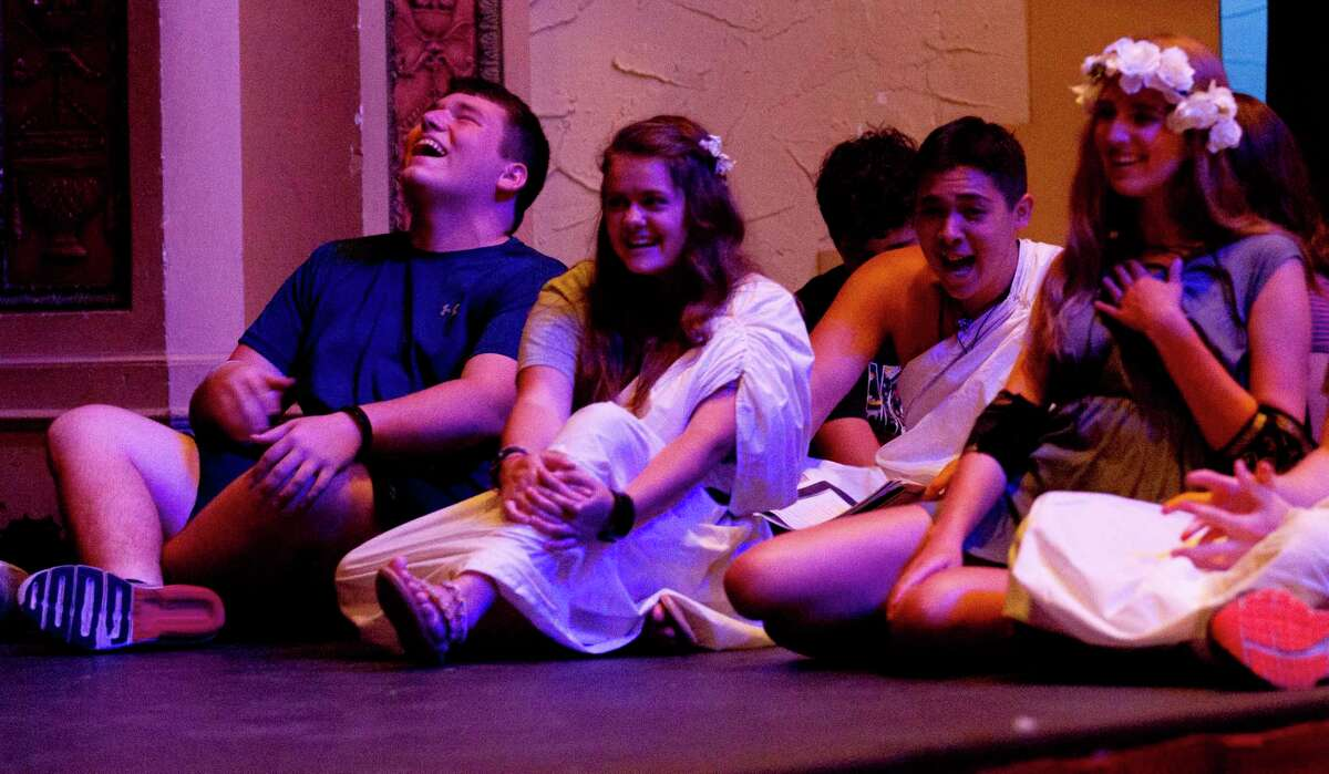 """Actors laugh as they rehearse William Shakespeare's """"A Midsummer Night's Dream"""" as a part of the Crighton Theatre Youth Summer Camp, Tuesday, July 16, 2019, in Conroe. The show runs Aug. 1-4 at the Crighton Theatre."""