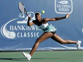 Venus Williams, of the United States, returns a shot against Stephanie Dubois, of Canada, in the Bank of the West tennis tournament in Stanford, Calif., Tuesday, July 28, 2009.