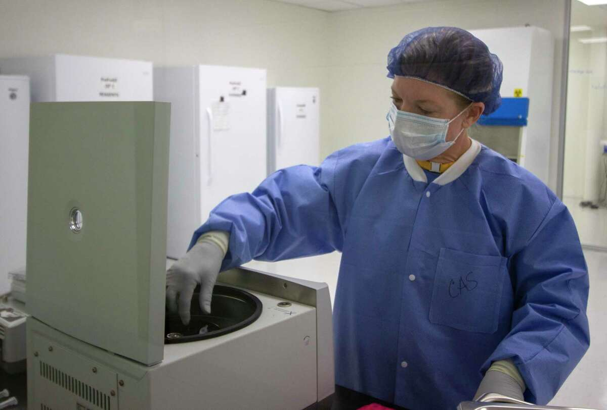 Senior scientist Christy Smejkal runs samples to extract DNA from Friday, July 12, 2019 at the Othram lab in The Woodlands.