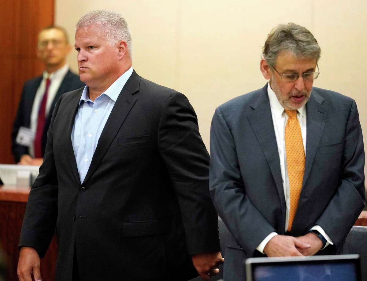 David Temple, left, is shown with his defense attorney, Stanley Schneider, during his murder trial in the 178th District Court Monday, July 8, 2019, in Houston. Temple is accused of killing his wife, Belinda Temple, in January 1999.