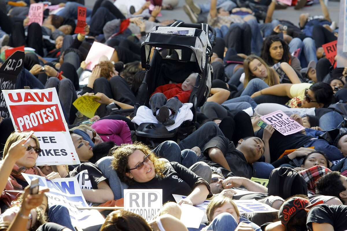 Hundreds of students lay down to symbolize the