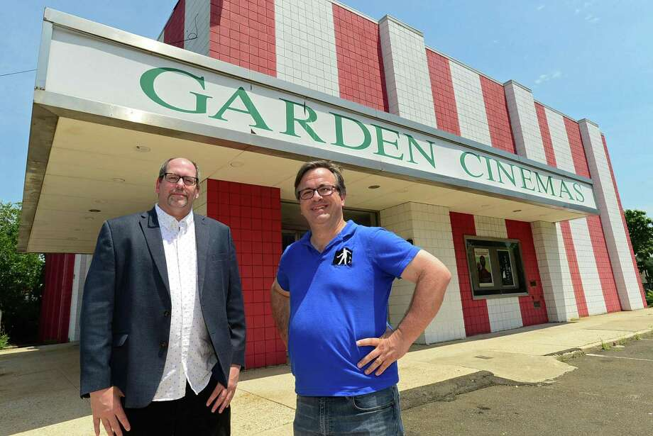 Wall Street Neighborhood Association members Marc Alan and Frank Farricker oustide The Garden Cinema on Isaac Street Tuesday, July 16, 2019, in Norwalk, Conn. A few days ahead of the public hearing on the proposed Wall Street Place development, which was knock down the Garden Cinema in order to build a parking structure, the Wall Street Neighborhood Association is campaigning to save the theater. Photo: Erik Trautmann / Hearst Connecticut Media / Norwalk Hour