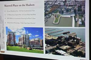 A slide is shown on past projects as Troy residents and business owners listen as officials from Hoboken Brownstone Co. talk to them about what they've done in the past in other cities and plans for redeveloping 1 Monument Square at the Arts Center of the Capital Region on Tuesday, July 16, 2019 in Troy, N.Y. (Lori Van Buren/Times Union)