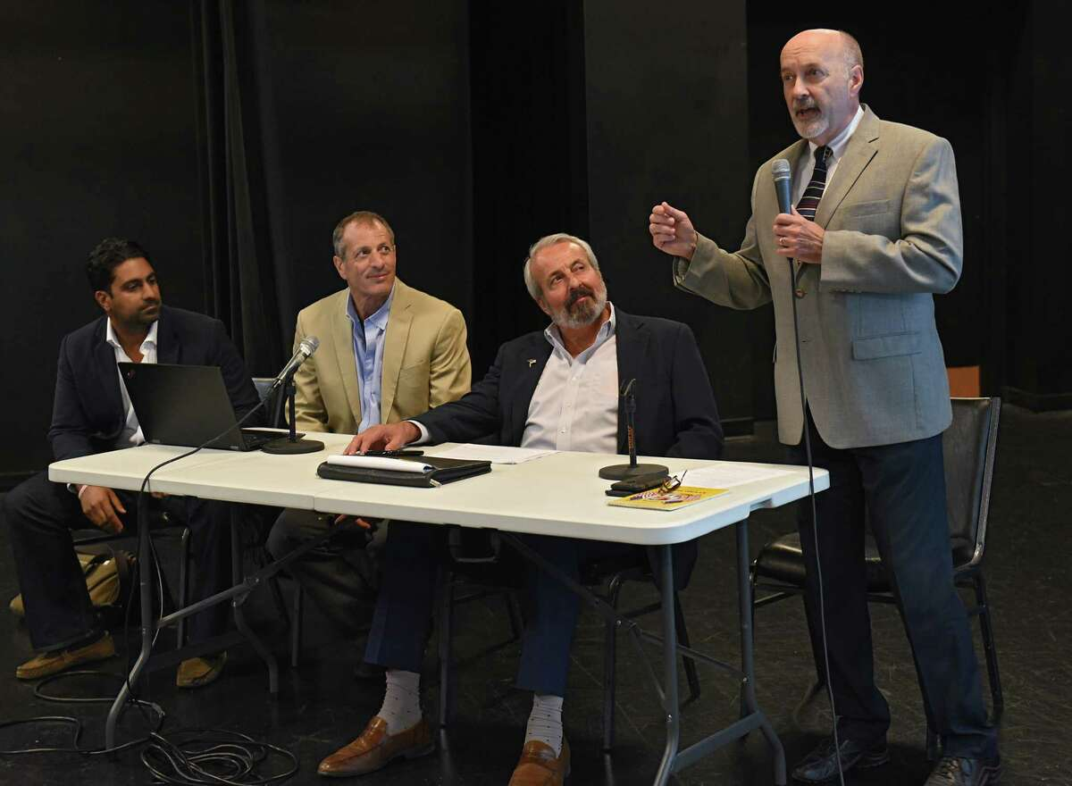 Troy Mayor Patrick Madden, right, speaks before officials from Hoboken Brownstone Co., left, talk to residents and businesses about plans for redeveloping 1 Monument Square on Tuesday, July 16, 2019 in Troy, N.Y. Sitting, from left, are Someet Gupta, Daniel Gans and George Vallone. (Lori Van Buren/Times Union)