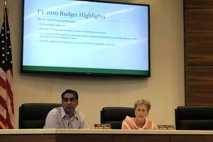 Bellaire City Council members Neil Verma and Trisha Pollard listen to discussions about the city's proposed budget for fiscal year 2020 at City Gall on Monday, July 15.