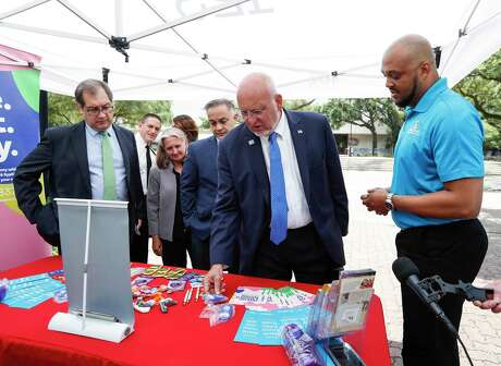 Robert Redfield, director of the federal Centers for Disease Control and Prevention, speaks to Franaldo Curl, the Harris County Public Health Department's HIV prevention coordinator, at their mobile HIV testing unit after a meeting with local officials, Monday, July 15, 2019, at Texas Southern University.