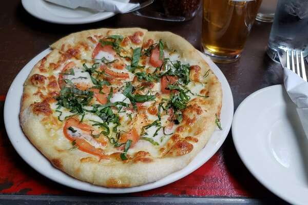 Alibi Room Daily 11:30 a.m.-6 p.m.; Pizza ($4-$5 drinks, half off specialty pizzas, $5-$7 appetizers)