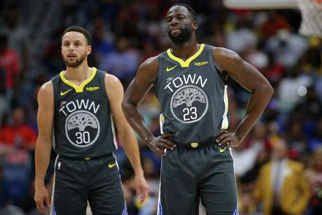 Stephen Curry #30 of the Golden State Warriors and Draymond Green #23 reacts during a game against the New Orleans Pelicans at the Smoothie King Center on April 09, 2019 in New Orleans, Louisiana.