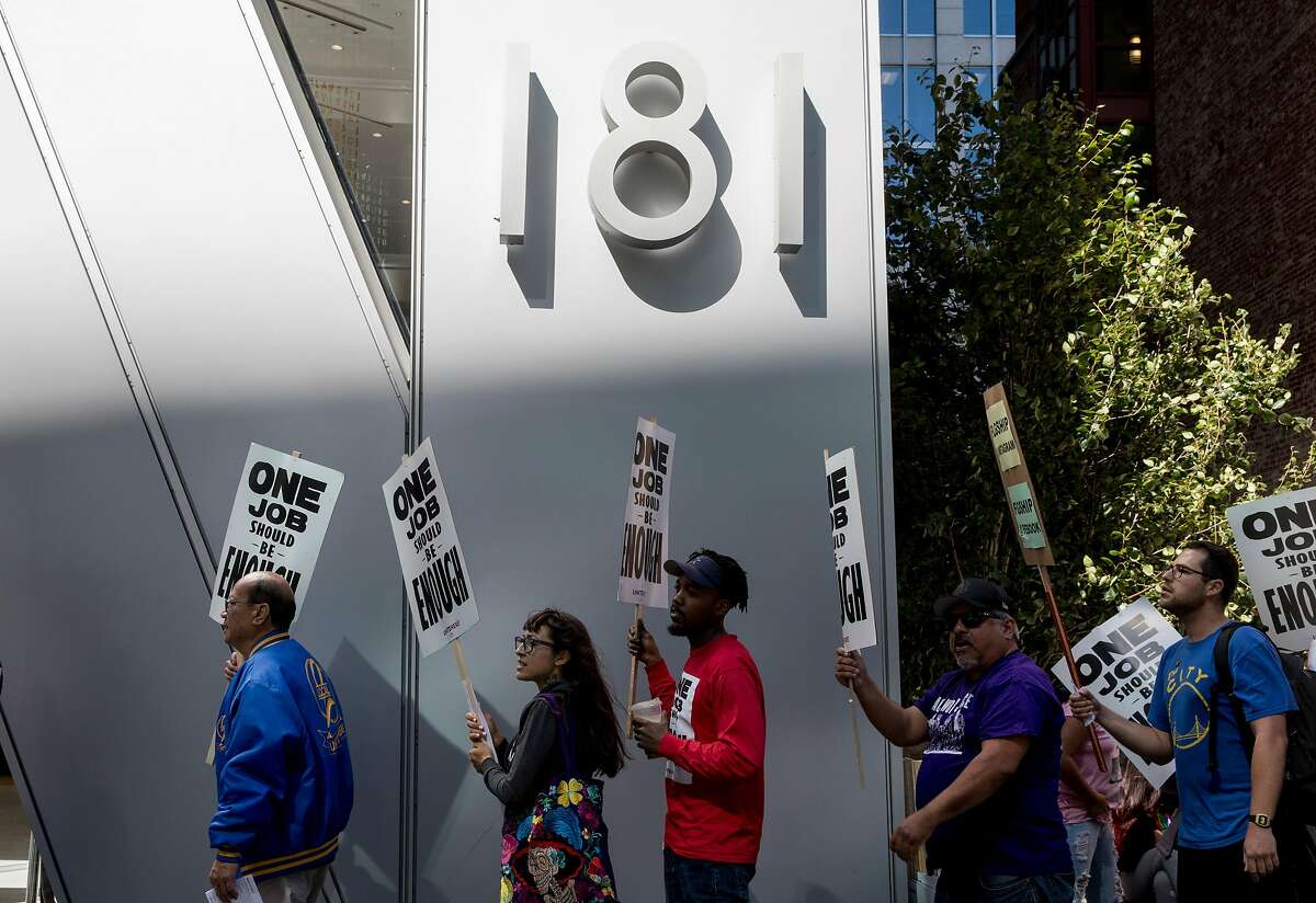 Union Local 2 members, Flagship cafeteria contract workers and supporters march with signs during a protest held outside of the Facebook offices in San Francisco, Calif. Tuesday, July 16, 2019.