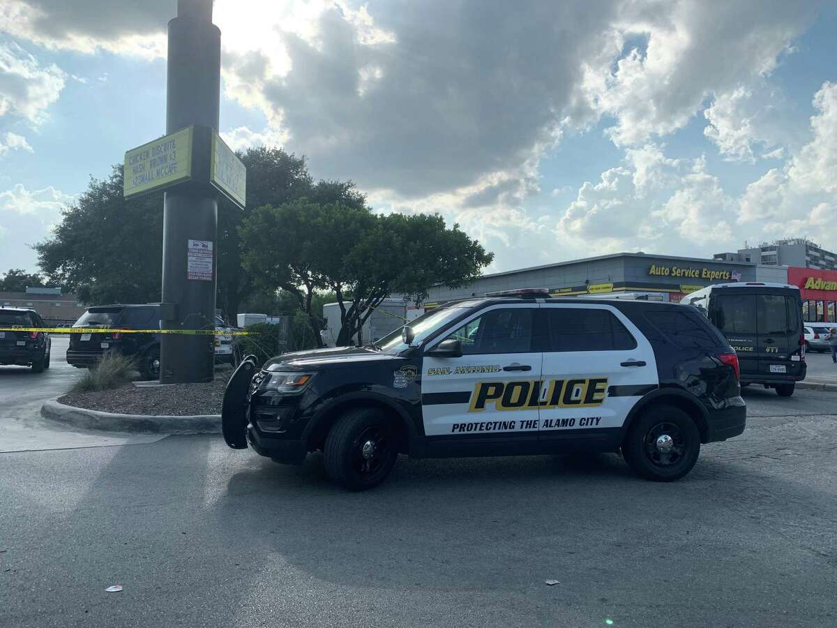 Police investigate the scene of a shooting in the 6900 block of San Pedro Avenue on Tuesday afternoon. One man was arrested in the shooting that left four people injured at a moving company, police said.