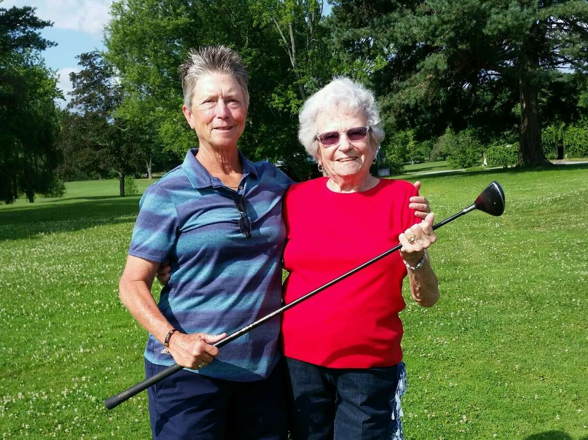 KathyA Canestrini, left, with Jan Monty, holding a 7-wood Jan's late husband John made by hand. Canestrini had an ace at the Country Club of Troy's Women's Invitational on July 8, 2019 using the 18-year-old fairway wood. Monty and Canestrini met up to celebrate the ace at Western Turnpike Golf Course during the annual member-guest tournament on Sunday, July 14, 2019. (Provided)
