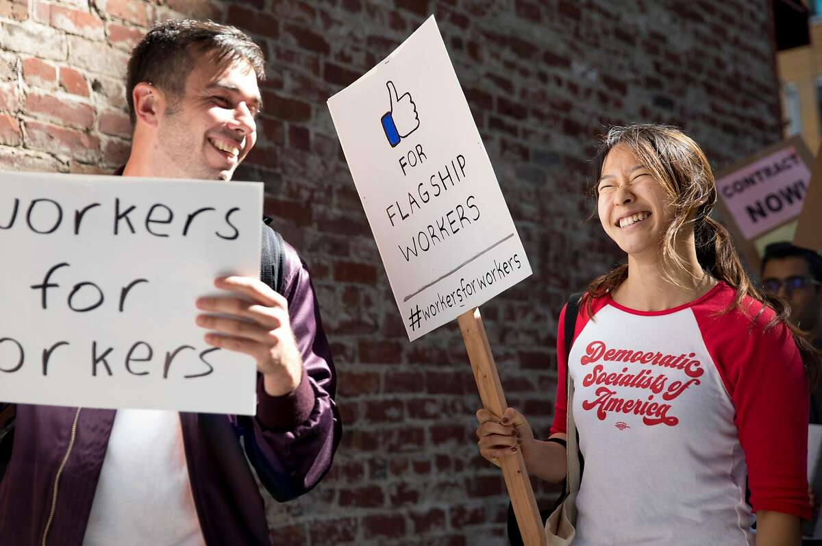 Former tech worker Wendy Liu (right) marches with Unite Here Local 2 members, Flagship cafeteria contract workers and supporters during a protest held outside of the Facebook offices in San Francisco, Calif. Tuesday, July 16, 2019.