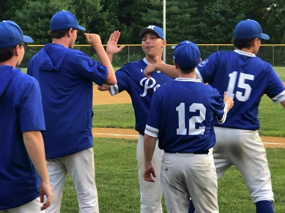 Post 75 pitcher Tyler Lemay, center, is greeted by his teammates after finishing off a six-hitter in a 9-0 victory over Glastonbury. Photo: Paul Augeri / For Hearst Connecticut Media