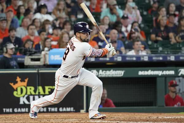 Houston Astros' Robinson Chirinos bats against the Los Angeles Angels during the eighth inning of a baseball game Sunday, July 7, 2019, in Houston. (AP Photo/David J. Phillip)