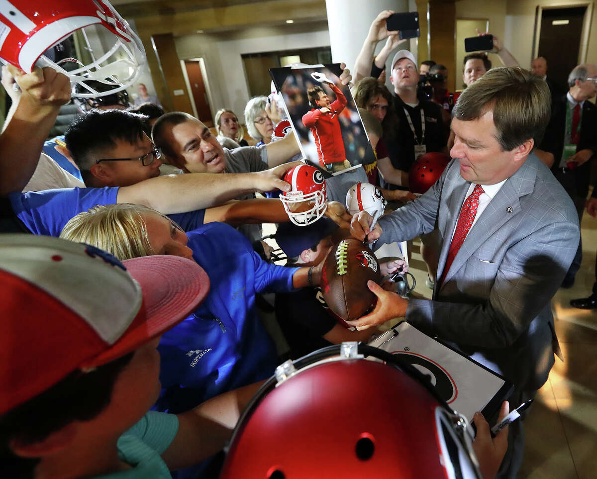 Georgia head coach Kirby Smart signs autographs for fans as he arrives in the lobby on Tuesday, July 16, 2019 at the Hyatt Regency Birmingham-Wynfrey Hotel during SEC Media Days in Birmingham, Ala. (Curtis Compton/Atlanta Journal-Constitution/TNS)