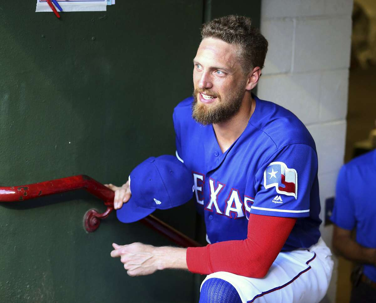 Texas Rangers designated hitter Hunter Pence (24) stands in the dugout before a baseball game against the Arizona Diamondbacks Tuesday, July 16, 2019 in Arlington, Texas. This is Pence's first game back after being on the injured list. (AP Photo/Richard W. Rodriguez)