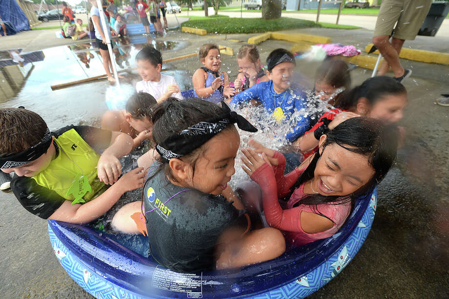 Children enjoy the outdoor water fun as they take in the spiritual messages and theme of Jonah and the Whale during Vacation Bible School at First Baptist Church of Groves Tuesday. Photo taken Saturday, July 13, 2019 Kim Brent/The Enterprise Photo: Kim Brent