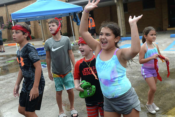 Children enjoy the outdoor water fun as they take in the spiritual messages and theme of Jonah and the Whale during Vacation BibleSchool at First Baptist Church. of Groves Tuesday. Photo taken Saturday, July 13, 2019 Kim Brent/The Enterprise